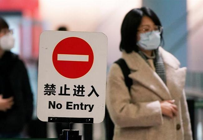 Kinijoje augant viruso aukų skaičiui įvedama naujų susisiekimo apribojimų