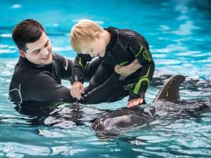Delfinai įveikia net autistų bendravimo barjerą